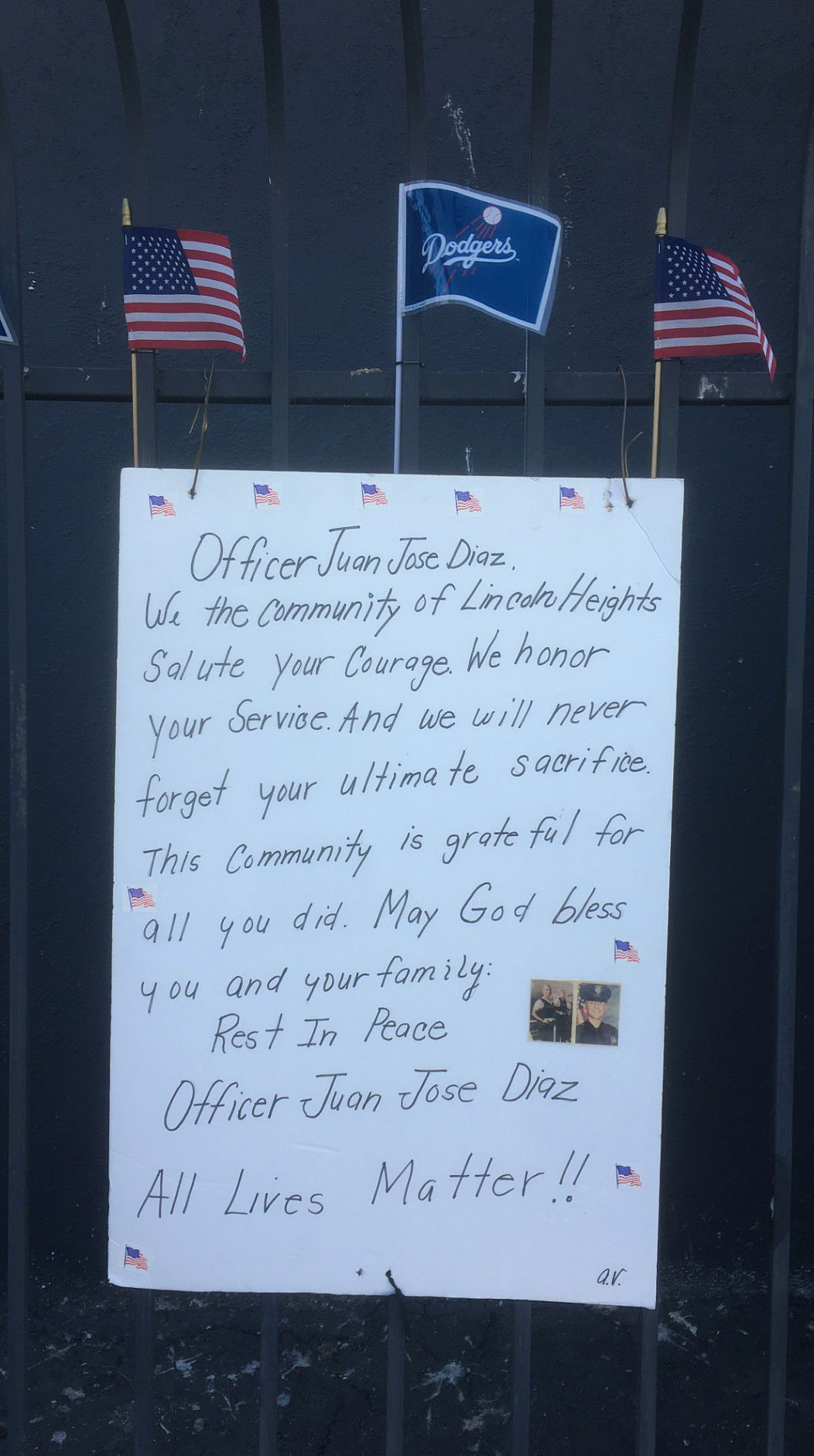 Farewell message to Juan Diaz hanging from a fence in Lincoln Heights