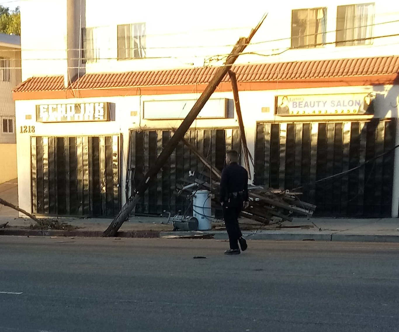 Damaged utility pole and lines