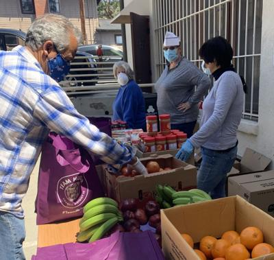 Preparing produce for Eagle Rock food giveaway