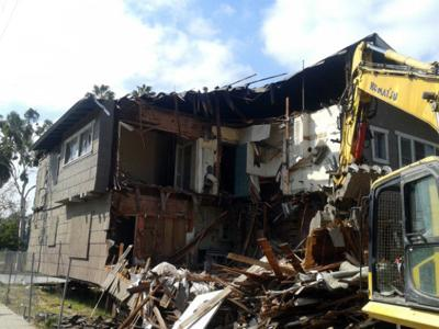 Demolition crew catches up with Echo Park Craftsman apartment house