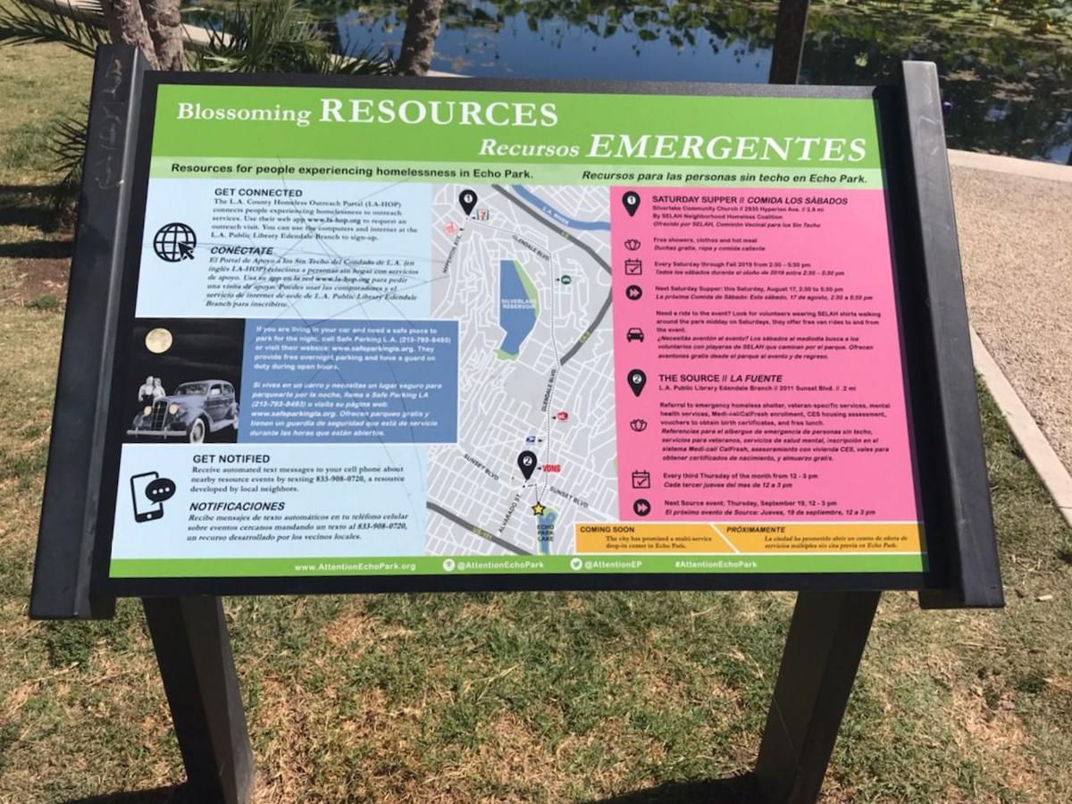 Echo Park Lake homeless sign Blossoming Reserouces