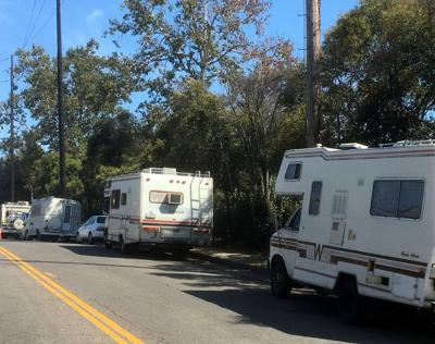 Campers and RVs parked on Bellevue in Angelino Heights