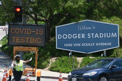 line of cars dodger stadium coronvirus testing site first day jesus sanchez 5-16-2020 1-09-039.JPG