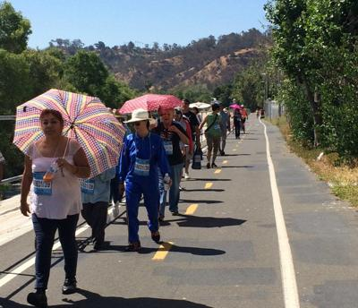Elysian Valley residents take a walk to improve safety along the L.A. River path