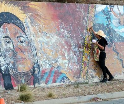 Artist works to repair a 170-foot-long Mount Washington mural -- one brush stroke at a time