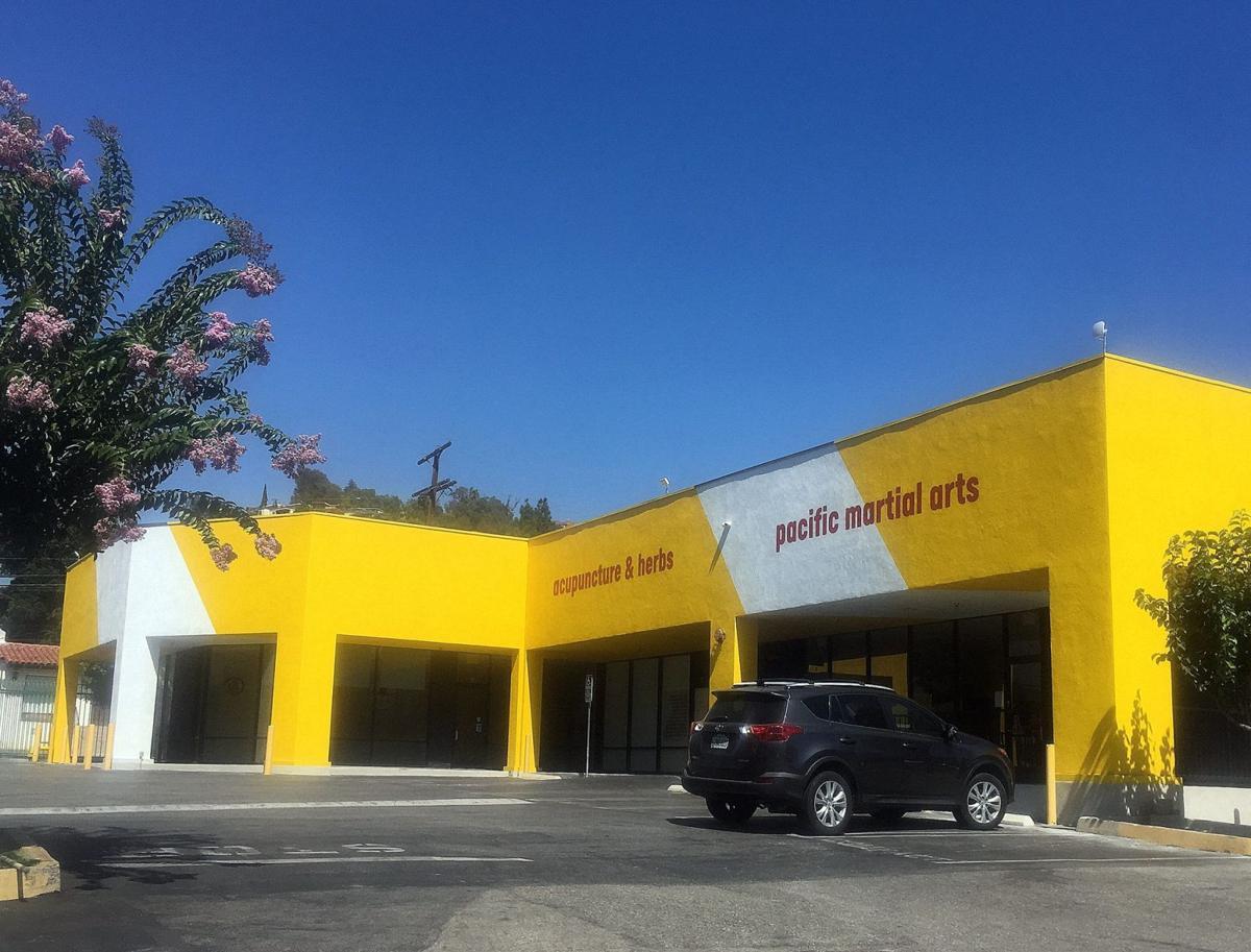 Yellow and white Verdugo Plaza buildings