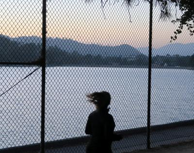 Runner in front of Silver Lake Reservoir Fence