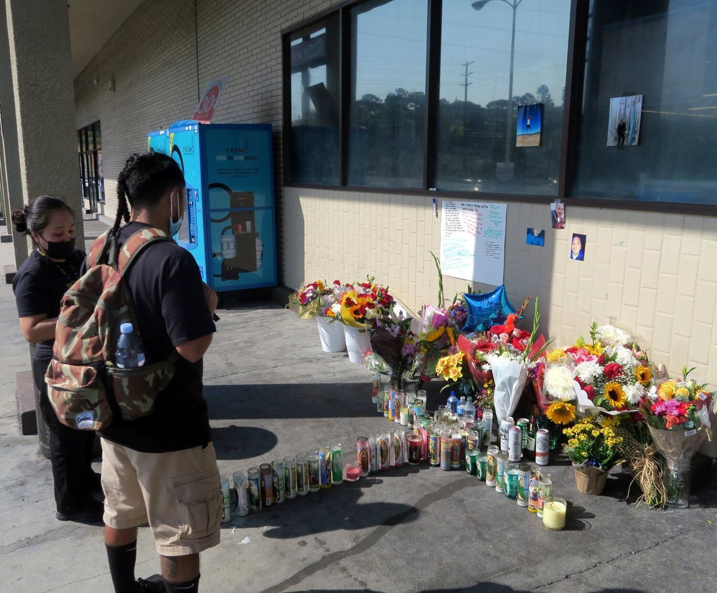 Rite Aid shooting memorial flowers and candles