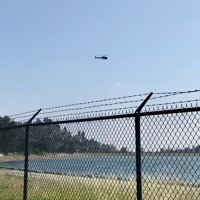 Helicopter hovering over Silver Lake Reservoir