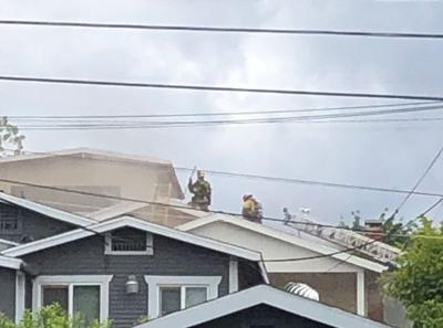Firefighters on rooftop 1400 block of N. Mt. Pleasant Avenue