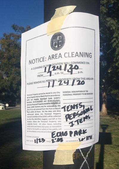Homeless encampment cleanup notice at Echo Park Lake
