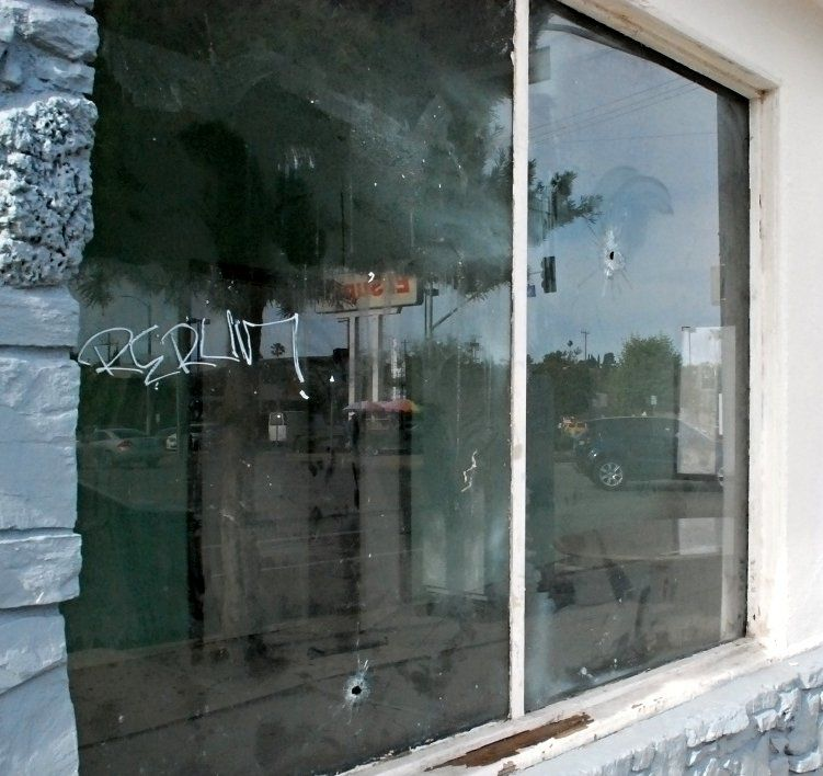 ChildsNext door bullet  holes highland park and brenda rees.jpg