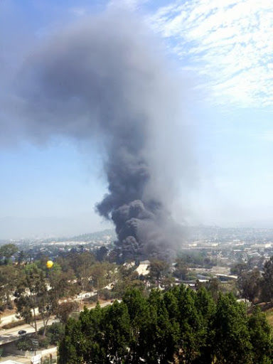 Tanker truck fire burning near 2 and 5 freeways; burning fuel spills into L.A. River*