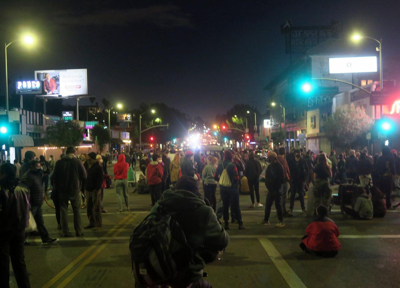Police and protestor standoff in echo park