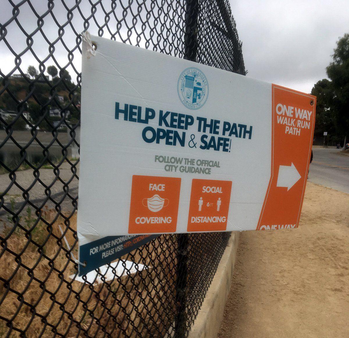 vandalized silver lake reservoir one way sign eastsider reader.jpg