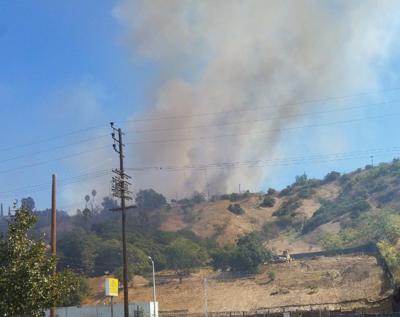 Brush fire threatening some homes in El Sereno