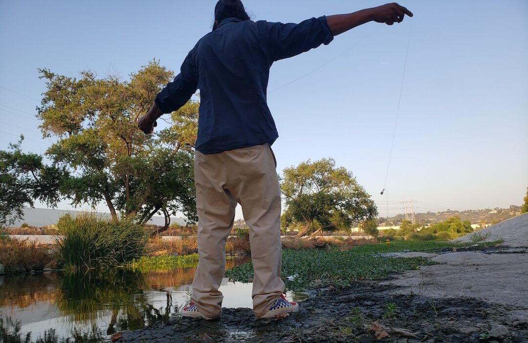 About to cast a fishing line in the L.A. River