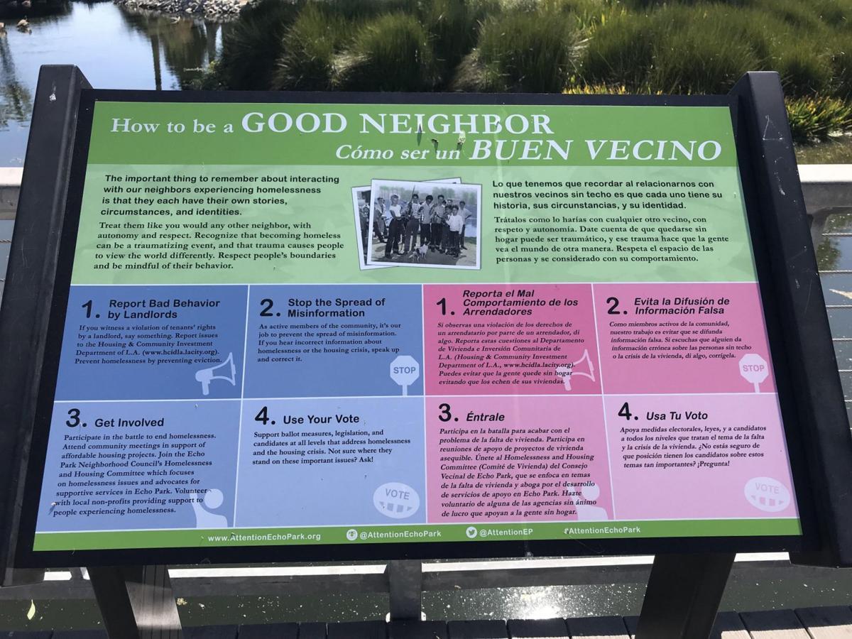Homeless guerilla art signs at Echo Park Lake