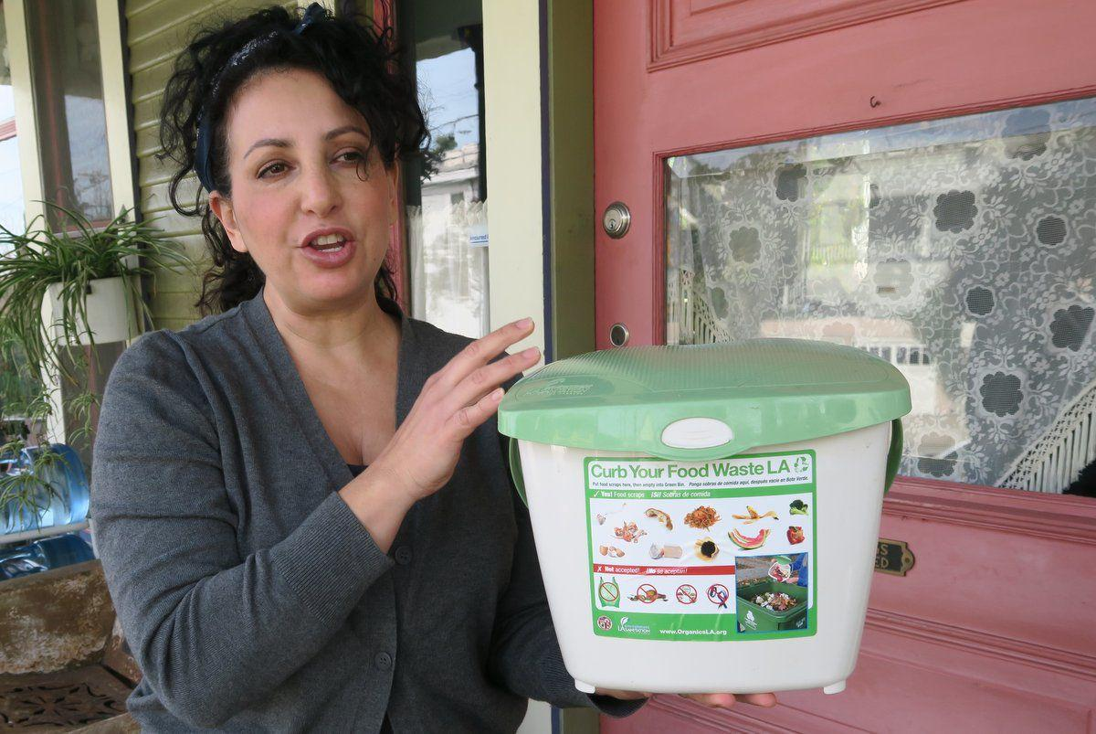 Madalyn Rofer-Choate with Curb your Food Waste Bin