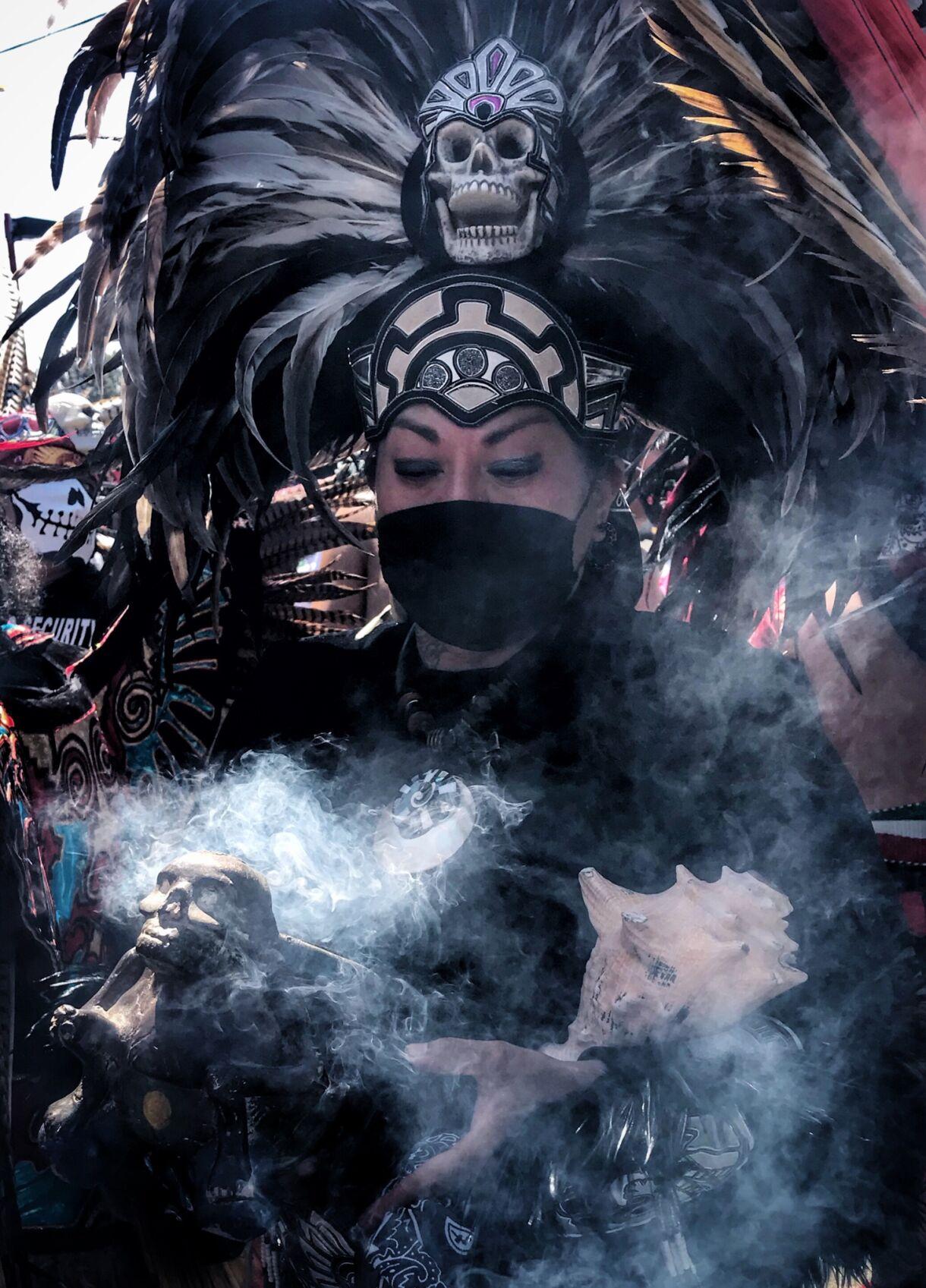 Aztec Dancer with incense Chicano Moratorium 50th anniversary