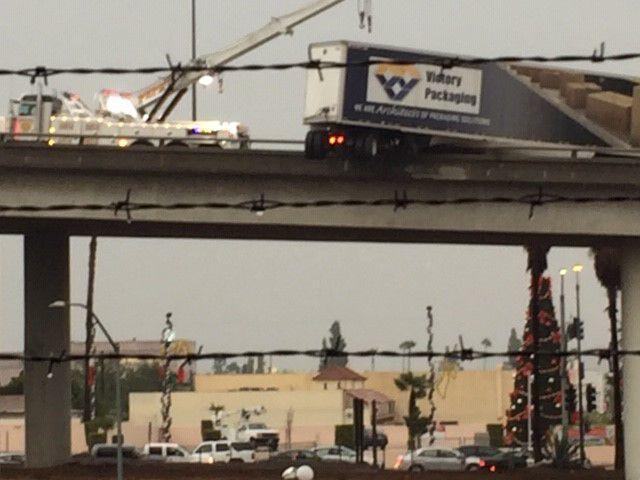 Big rig hangs over side after crash at 710 and 60 interchange in East LA
