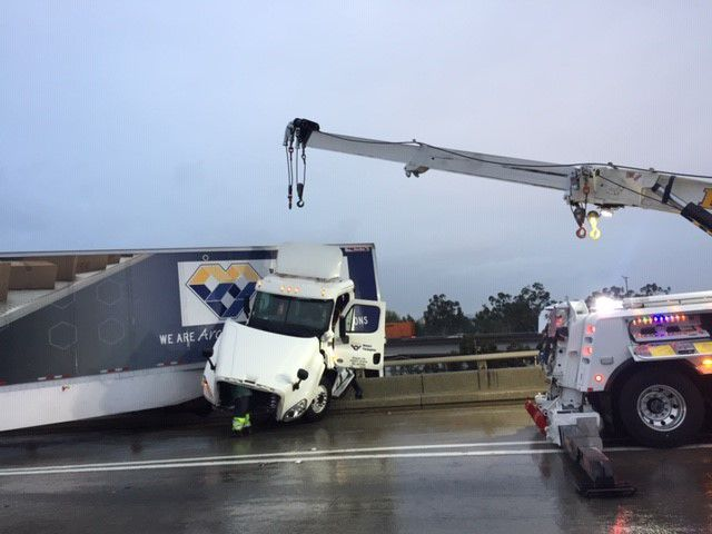 Crane used to rescue big rig on the 710 and 60 interchange in East LA