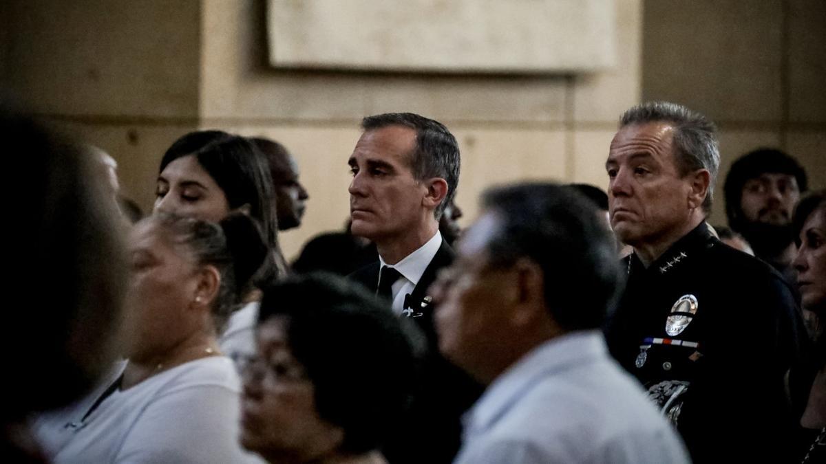 Eric Garcetti and Michel Moore at memorial service for juan jose diaz courtesy mayor of Los Angeles.jpg