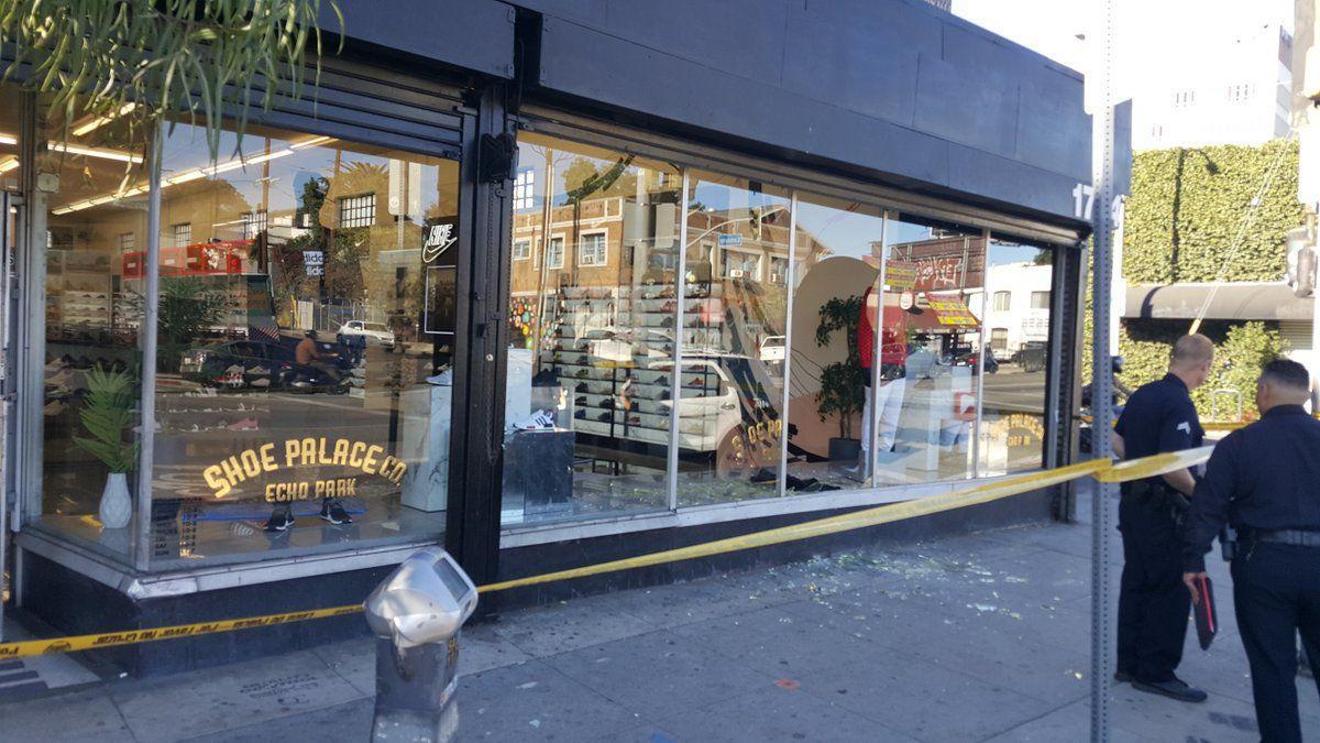 Broken window shoe palace echo park  yellow tape