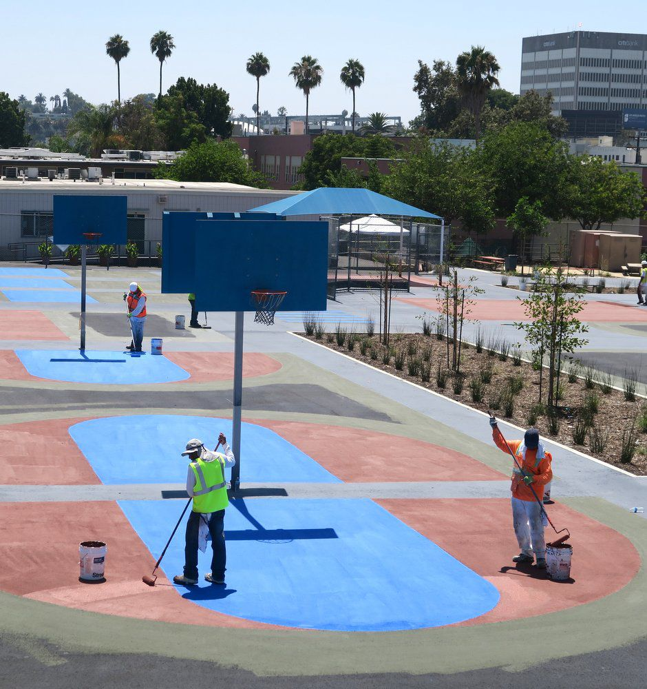 Logan Street basketball courts and playground being painted