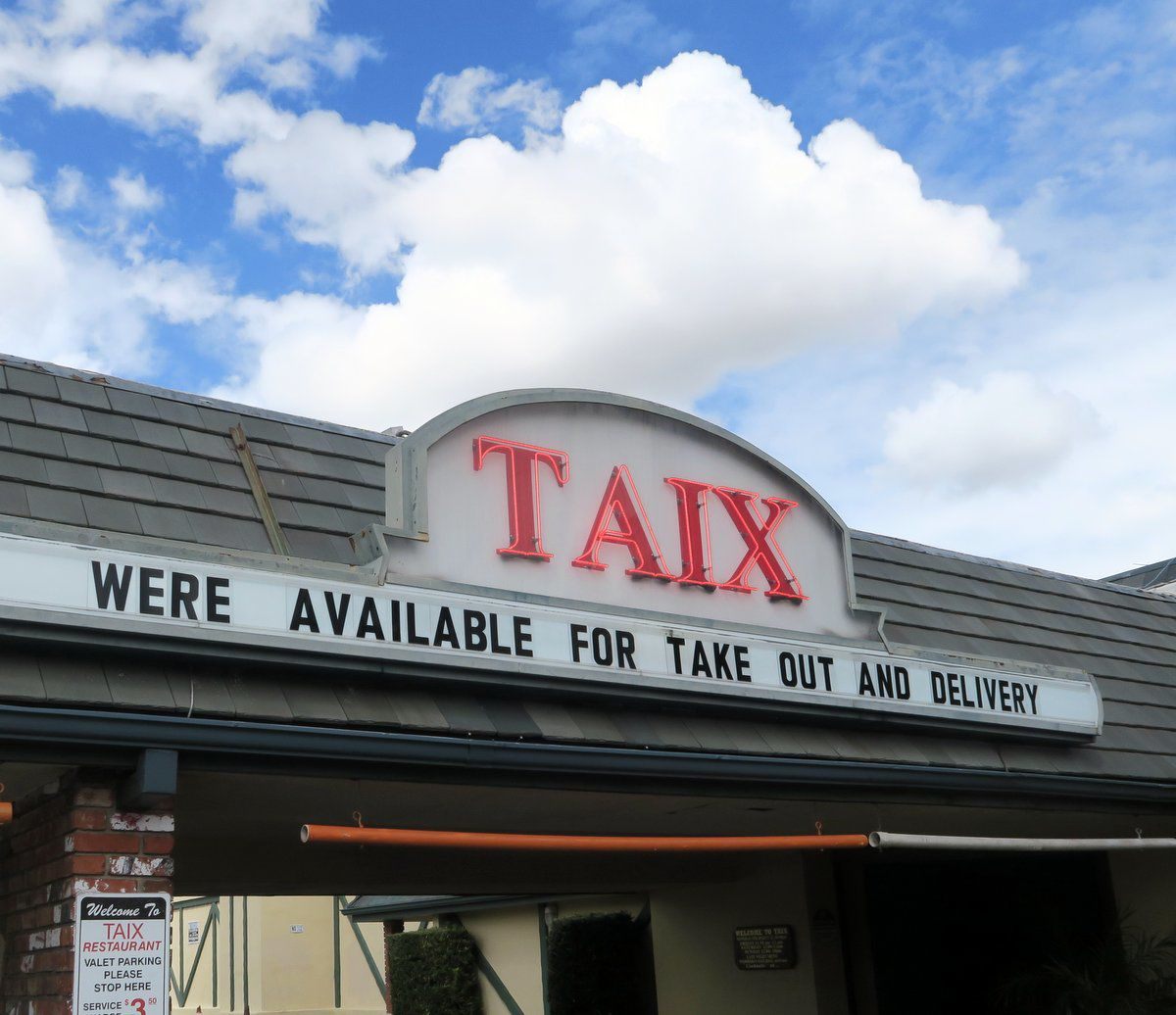 Taix takeout sign after coronavirus restrictions