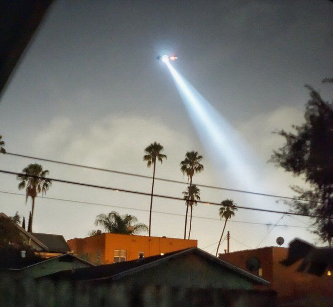 Police helicopter hovering over Echo Park