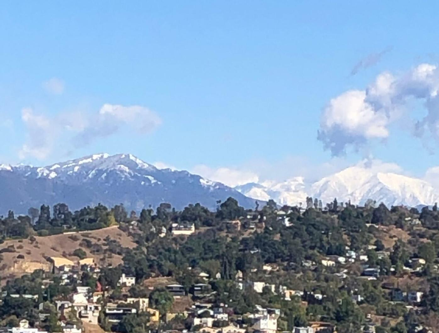 Snow capped mountain view from Elyisan Heights