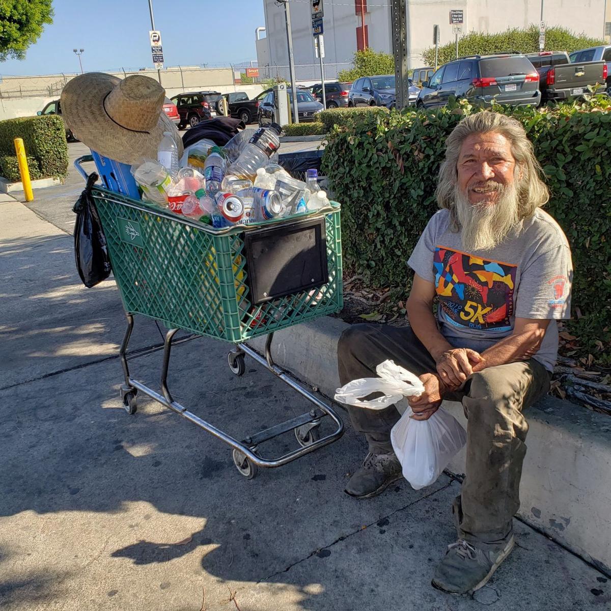 Portrait of Jaime Sosa as he smiles and thanks a volunteer for the food (Amairani Hernandez_UT).j.jpg