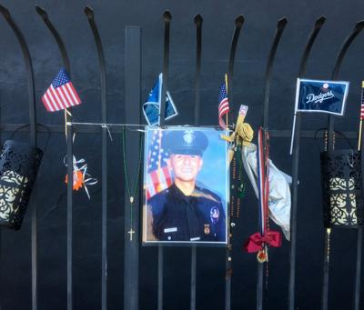Memorial to Juan Jose Diaz hanging from a fence in Lincoln Heights