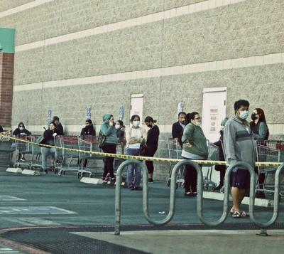 Customers with face masks lined up at Costco in Atwater Village