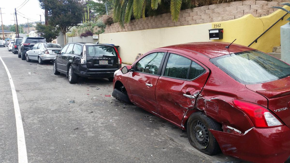 Damaged cars on Griffin Avenue in Lincoln Heights