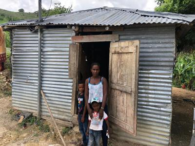 Families in Las Lomas, in the sister Diocese of San Juan de la Maguana, are used to living in makeshift homes. The Mission Office now offers residents a chance for sturdy shelter. (COURTESY)