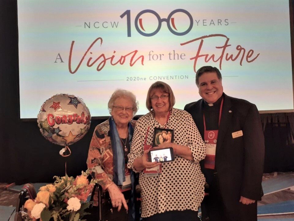 ODCCW member Julie Drake (left) and NCCW chaplain Father Miguel González stand with Kathy Bonner, recipient of the NCCW Our Lady of Good Counsel award.