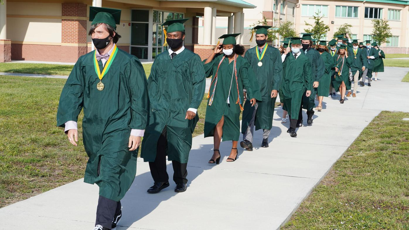 Melbourne Central Catholic High School students head to the field for graduation May 21.