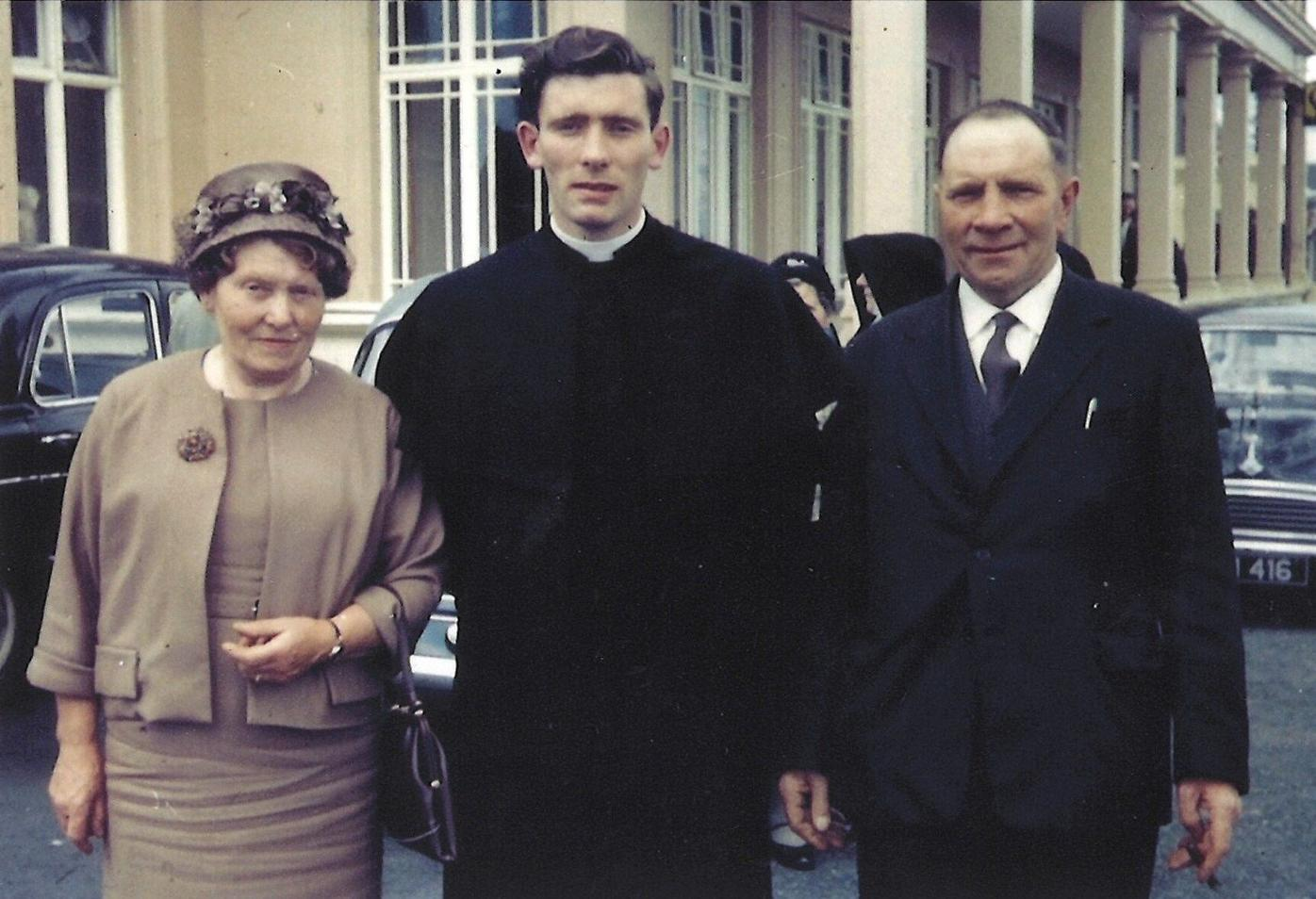 Monsignor John Bluett, June 13, 1963 on the day of his Ordination to the Priesthood, with his parents in Ireland. (COURTESY)