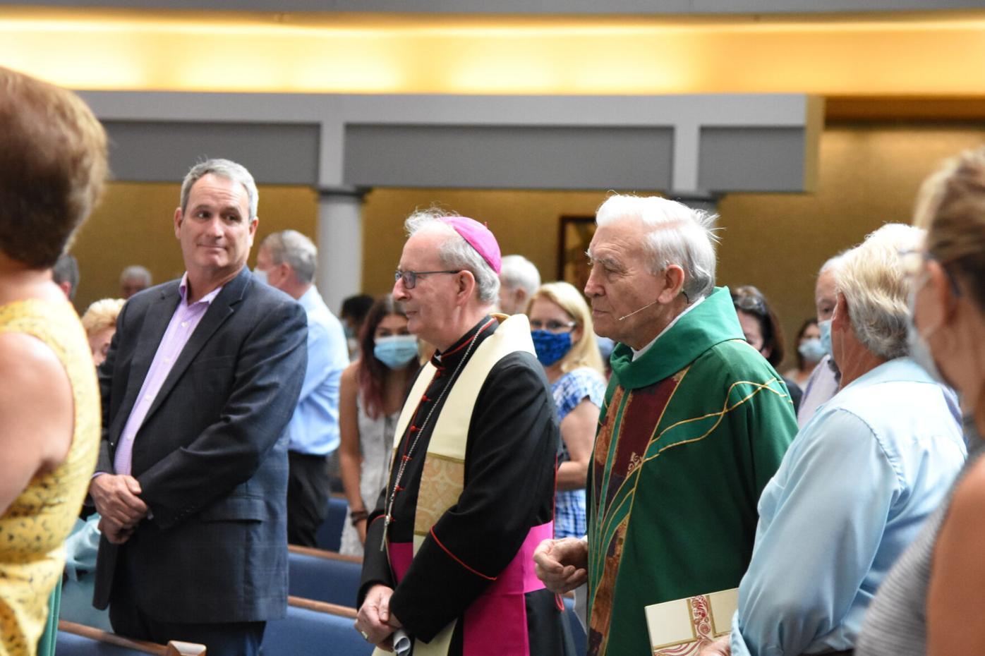 Bishop John Noonan (left) and Monsignor John Bluett at monsignor's farewell Mass, June 13. Both priests are from Limerick, Ireland. (GLENDA MEEKINS)