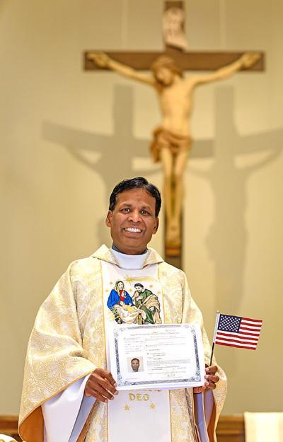 Father John Britto, C.S.C., parochial administrator of St. John the Evangelist Parish in Viera becomes a U.S. citizen.