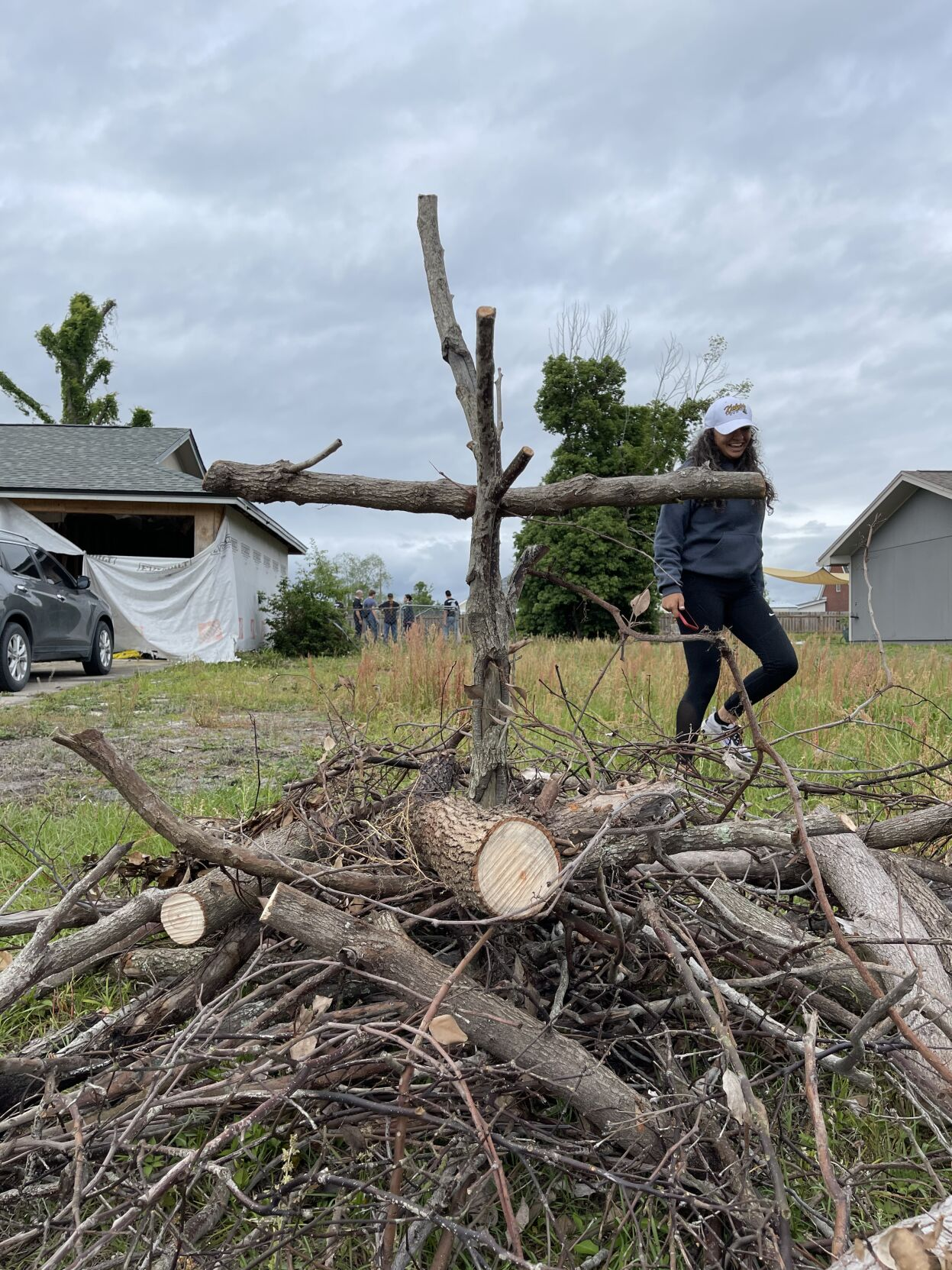 Students from UCF Catholic Campus Ministry spend their Spring Break helping others by cleaning up existing debris from Hurricane Michael and recent tornadoes in Panama City, April 11-217. (COURTESY)