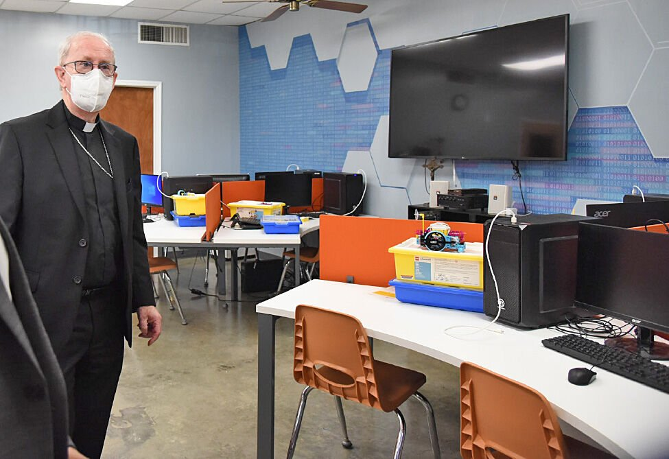 Bishop John Noonan gets a tour of renovations to the Science Lab