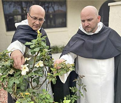 St. Ann pastor and former Dominican, Father Alfonso Cely (left) and Dominican Father Duberney Rodas Grajales celebrate the 800th anniversary of St. Dominic's death.