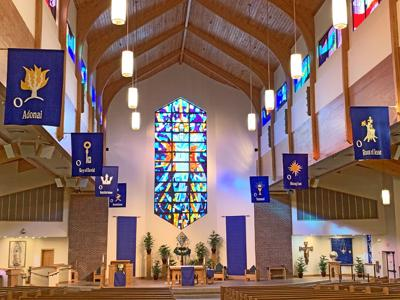 "Eight new 42"" x 5' banners inspired by the Benedictine Sisters of Turvey Abbey, hang at St. Patrick Parish in Mount Dora. The parishioner-made banners help the faithful focus on Advent Scripture passages."
