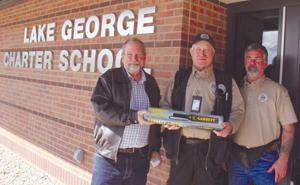 <p>High Country Realty businessman John Magoon (left) presented a Garrett metal detection wand to security team member Keith Lanz (center) and Security Manager Rex Oliver (right).</p><p>(Photo by Sonja Oliver)</p>