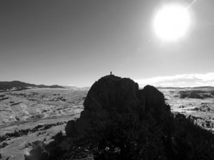 <p>Dave Cooper stands on the south summit of Eagle Rock, as seen from the north summit. The Puma Hills are on the left, beyond Ruby Gulch, and South Park stretches off to the right. (Photo by John Rankin/The Flume)</p>