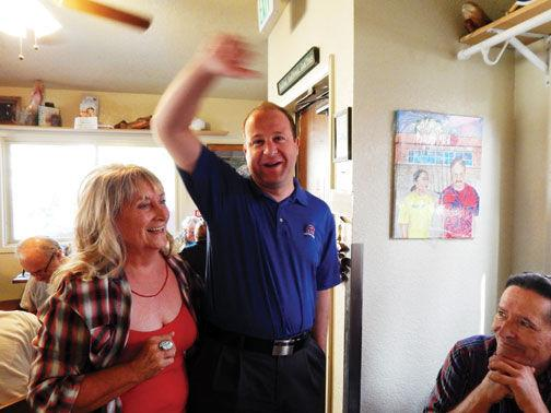 Meet and greet the rep theflume free content terry creech brunt left of pine greets representative jared polis with a hug at the cutthroat cafe aug 22 during a town hall meeting with polis m4hsunfo