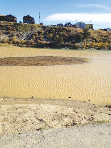 Sediment and mine waste cover the Fairplay beach area